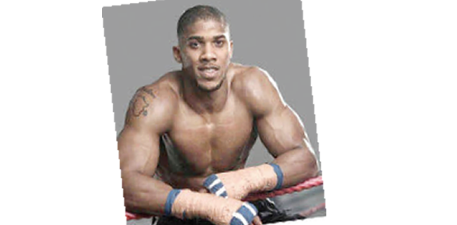 Joshua keen to defend his titles in Nigeria