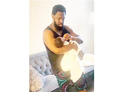 Timaya shares photo feeding son on birthday