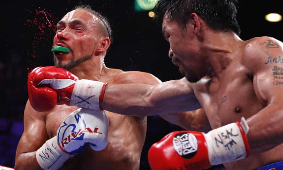 Boxing: Pacquiao rolls back years in split-decision win over Thurman