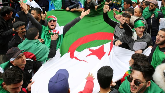 … as Algerians storm Cairo Stadium with 21 buses