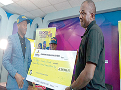 Petty trader wins scholarship lottery for kids