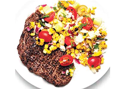Grilled steak with Greek corn salad