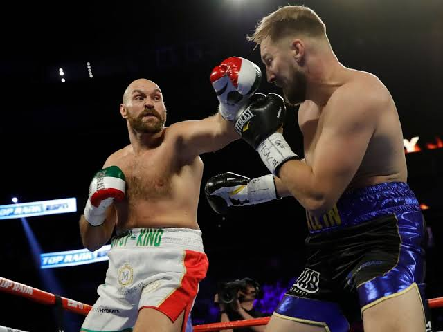 Boxing: Bloodied Fury beats Wallin on points