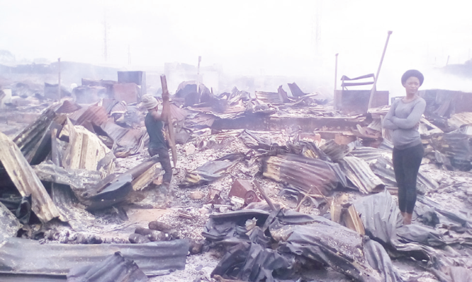 Trader slumps, dies as fire guts market
