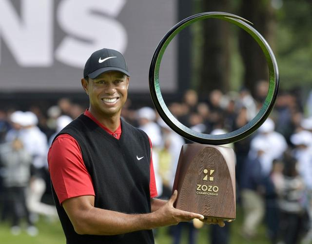 Woods wins in Japan, ties Snead for PGA Tour record with 82nd victory