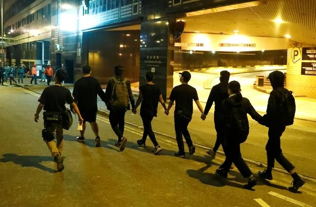 Handful of Hong Kong protesters surrender as varsity siege nears end