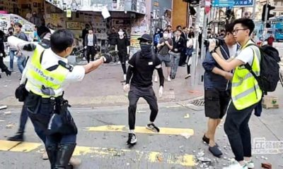 Hong Kong police officer shoots protester in early morning clashes