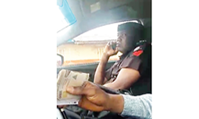 Camera nails policeman collecting N15,000 bribe