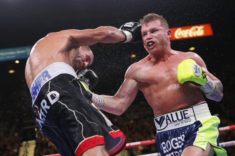 Boxing: Alvarez stops Kovalev in 11th round to win 175-pound title