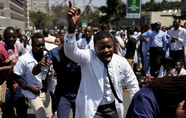 Zimbabwe fires 211 striking doctors as economy worsens