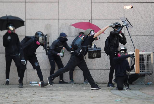 Hong Kong protesters hurl petrol bombs in fresh varsity clashes