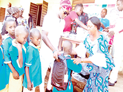 Initiative lifts 200 pupils' learning with school materials, bags
