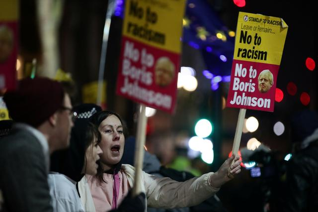 'Not my prime minister', protesters march in London against Johnson